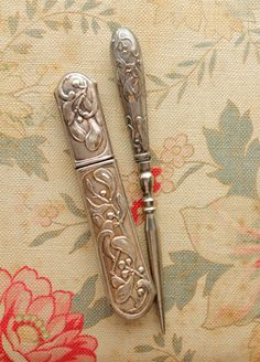 """white metal needle case & bodkin - nouveau-esque mistletoe. When Hamlet refers to a """"bare bodkin,"""" he is thinking of something along these lines: a small dagger."""