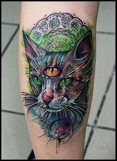 Three eyed cat tattoo