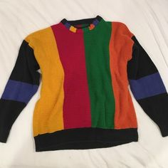 Vintage Crayola Colored Sweater not UNIF but very similar to their Crayola sweater! in great condition, soft, warm, no holes or stains. found in a thrift store, no tag on it but could fit S-L depending on the style you're going for. UNIF Sweaters