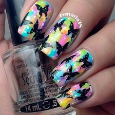 Black stamped butterflys on colorful pastel background. Butterfly nail art design.