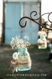 Blue Mason jars, wrapped with burlap (could add lace) with baby's breath. Cute table centerpieces, and baby's breath is cheap!!