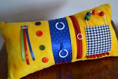 Yellow activity pillow for those with Alzheimer's or other dementia, by Memory Lane Sewing.  Items for sensory stimulation for those in mid to late stages of Alzheimer's.