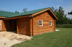 Pine Log Siding with a Cedar Tone Topical Stain/Sealer and fake log corners. Heart Pine Flooring, Pine Floors, Log Cabin Siding, Exterior Siding, Home Repairs, Exterior Lighting, House Colors, House Plans, Shed