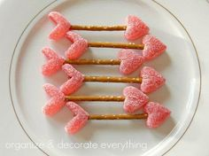 Arrows made from candy hearts and pretzels. Cute! #valentinesday