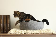 Handmade felt cat cave from 100% wool. Basket  If you want bigger cave, please write me size or cat weight, I will do a specially for you.  My products are handmade, so decor might slightly...