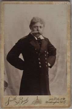 An eccentric looking man with a large mustache