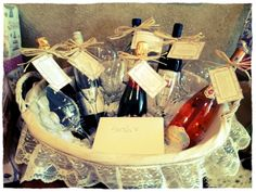 Great wedding shower gift! A basket filled with different wines for different milestones in the couples married life. It consists of a bottle for their wedding night (champagne), first anniversary (blush wine), first dinner party (white wine), first fight (red wine), first Christmas Eve (white wine), and first baby (sparkling grape juice). Also includes 2 red wine glasses, 2 white wine glasses, and 2 champagne flutes. Each bottle has a tag and poem to describe what it is for.