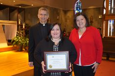 Christy Papania-Jones was the 2015 recipient of the St. Margaret Catholic School Distinguished Graduate Award. Pictured also- Father Bill Miller and Mrs. Wendy Wicke, school principal.