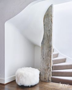 """""""All of this work was completed with hand tools back in the day. The details were done so perfectly that we decided to utilize the materials that were available back then,"""" says builder Mark Hickman of this 1920s #Hinsdale home, where he installed a sculptural stucco stairway which envelopes a reclaimed wood post. #LuxeCH Jan/Feb Builder: Mark Hickman Photo: mrobinsonphoto  @sandow • • • #instaluxe #luxuryinteriors #luxurymaterials #sculptural #stucco #reclaimed #renovation #eyeondesign"""