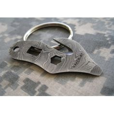 Damascus Key Ring Tool - key ring emergency tool for cutting your seat belt, opening a small bottle of oxygen, a pry bar/screwdriver flat tip, and to open your favorite metal capped beverage.
