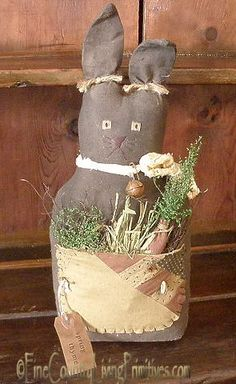 Spring Thyme Primitive Bunny with quilted bocket filled with primitive goodies!  www.finecountrylivingprimitives.com