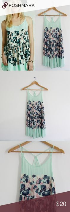 "Intimately Free Strappy Mint Floral Voile Dress Light Green mint colored, floral, and strappy dress! Free People is no longer selling this dress so it is limited edition!  Size: M Brand: Intimately Free by Free People Material: 100% Rayon Condition: Good condition, has a very tiny hole on the bottom area on front (shown in close up pic) barely noticeable though.  MEASUREMENTS  (Taken while laying flat)  Length: 32"" Chest: (underarm to underarm) spreads to 18"" Waist: spreads to 18"" Dresses"