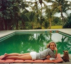 'Having a Topping Time', socialite Alice Topping, relaxing by the poolside in Palm Beach, 1959, by photographer Slim Aarons