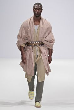 Grecian-Arabian-Persian look with a modern and African touch consisting of shorts, slouchy trousers and kaftan pieces of different shapes and sizes and shawls left the crowd with no jaws in astonishment