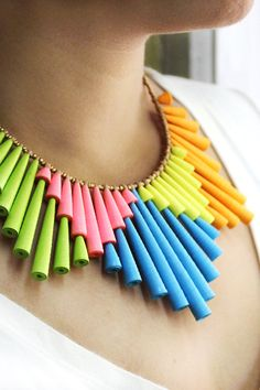 A big colorful statement necklace made from funky paper beads in bright neon colors. The bib features a fun geometric design that's creative and unique. The necklace is vibrant in pink, green, blue, yellow and orange. The paper beads are complimented by antique gold beads. The necklace has a hand formed sterling silver hook for closure. Funky Jewelry, Paper Jewelry, Paper Beads, Blue Yellow, Orange, Green, Lesbian Gifts, Summer Jewelry