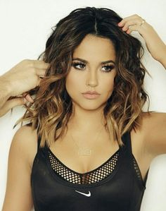 Dark brown / black ombre with blonde or copper ends. short wavy beach style hair.