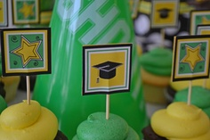 Graduation cupcake toppers for a dessert table by Sweet Design Company.