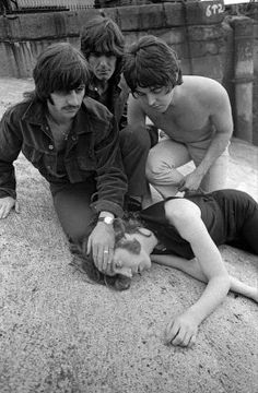 A shirtless Paul McCartney joins Ringo Starr and George Harrison as they crouch over John Lennon playing dead while at Wapping Pier Head in London - rather eerie in retrospect. Beatles Love, Les Beatles, Beatles Art, Beatles Photos, Fun Facts About Life, Lennon And Mccartney, She Loves You, The Fab Four, Classic Rock