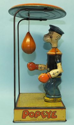 FOR SALE IN OUR STORE - ANTIQUE CHEIN POPEYE OVERHEAD BAG PUNCHER MECHANICAL TIN WIND UP BOXING TOY | Toys of Times Past  http://toysoftimespast.com/products-page/windups/antique-chein-popeye-overhead-bag-puncher-mechanical-tin-wind-up-boxing-toy-2/