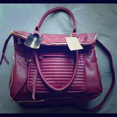 STEVE MADDEN WINE SATCHEL  Sooooo tempted to keep this SM. The color is a true maroon/wine with gold detailing. Hit that offer button Steve Madden Bags