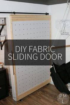 This DIY Sliding Fabric Door is a great idea if you want to save money on a barn door! The Effective Pictures We Offer You About industrial barn door A quality picture can tell you many things. Diy Barn Door Plans, Diy Sliding Barn Door, Sliding Doors, Sliding Door Design, Diy Interior Door Panels, Interior Barn Doors, Temporary Door, Cool House Designs, Panel Doors