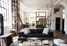 Loft, shelves, windows, poufs, coffee table, books, white pillows