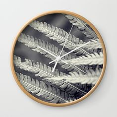 "Available in natural wood, black or white frames, our 10"" diameter unique Wall Clocks feature a high-impact plexiglass crystal face and a backside hook for easy hanging. Choose black or white hands to match your wall clock frame and art design choice. Clock sits 1.75"" deep and requires 1 AA battery (not included). #juledecule #wallclock #structure #homeinterior #blackandwhite"