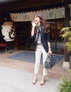 navy blazer, grey top and bag, cognac shoes outfit