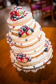 - Wedding cake with a lot of fresh fruit.