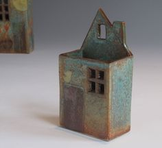 little houses designed to stand or hang on the wall by Margaret Wozniak