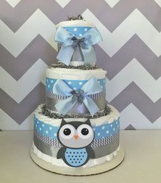 Deluxe Owl Diaper Cake in Blue and Gray, Owl Baby Shower Centerpiece for Boys, Owl Baby Shower Decoration by AllDiaperCakes on Etsy https://www.etsy.com/listing/244817519/deluxe-owl-diaper-cake-in-blue-and-gray