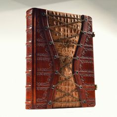 """I don't like that copy myself but this """"Corset Journal"""" just had to be made again...  Large Leather Corset Journal 11 x 8 inches in gift by aLexLibris, $450.00"""
