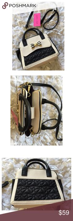 Mini dome bow satchel Gorgeous bone and black mini dome satchel from Betsey Johnson.  Zip top closure. Dual rolled carry handles with additional cross-body strap.  Exterior features a beautiful quilted bow design, metal bow accessory, and color block design throughout. Flat bottom base. Interior provides one bakck wall zip pocket with additional slip pockets. Measurements Bottom Width: 8 in, Depth: 3 3⁄4 in Height: 6 in, Strap Length: 49 in, Strap Drop: 23 in, Handle Length: 8 1⁄2 in, Handle…