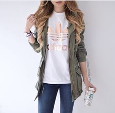 white and gold adidas, green jacket, light jeans