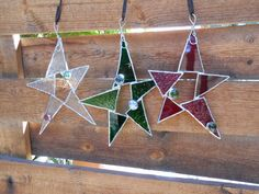 This listing is for the Clear glass Star. I have used 2 different textures of Clear glass in this Star. It measures 6 1/2 L x 5 6/8 W. It has 2 glass gems (1 red, and 1 green), and hangs from wire at the top of the star.