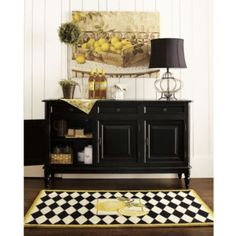 Storage idea for lobby to replace oval table by receptionist desk. Use with a large mirror / artwork and lamp.
