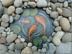 Paint a water scene including Koi, Lily Pads, and a Dragonfly on slate then cover with rocks.