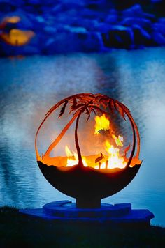Another Day in Paradise Palm Tree Steel Outdoor Fire Pit Sphere with Flat Steel Base.Palm trees, pelican and crane shorebirds and seagulls capture the feeling of this tropical paradise fire pit sphere. Fire Pit Sphere, Fire Pit Art, Metal Fire Pit, Tropical Fire Pits, Fire Pit Gallery, Outdoor Fire, Outdoor Decor, Custom Fire Pit, Number Art