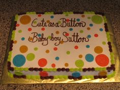 Cuts as a Button baby shower cake design.