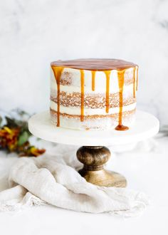 A showstopping cardamom spiced carrot cake with a sinful ginger cream cheese frosting and drippy caramel. DROOL.