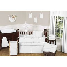 Complete the look of your nursery with this Minky Dot 9-piece bedding set from Sweet Jojo Designs. The bedding set includes decorative elements such as two valances, a pillow, a toy bag and a convenient diaper stacker. add color on walls, furniture, decor and accents