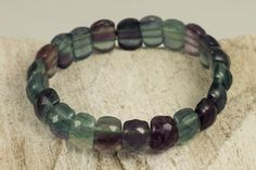 Faceted Rainbow Natural Fluorite Bracelet on double row stretch cord.  Length is approximately 7,25 inches which fits most wrist size.  How To Measure