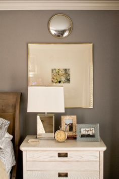 med tone bed, dark wall, white table