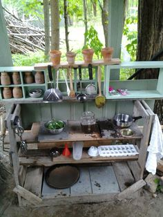 Backyard mud kitchen. Used scrap pallet wood, and unused kitchen gadgets