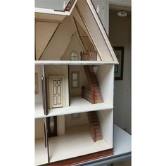 Ceiling height is 9 The house comes with milled exterior walls, round turret with precut to fit shingles, 8 working windows, 1 working main door, 2 working interior doors. Dollhouse Kits, Main Door, Ceiling Height, Dollhouses, Scale, Ships, Miniatures, Victorian, Shelves