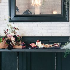 <p>A chandelier is draped in wispy greenery, the table is set in richrose gold details, and ahaunted grand piano is brimming withballoons. Now, take your seat... if you dare.</p>
