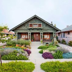 This flower-filled front yard is low-maintenance and eco-friendly. Low-growing, mounding perennials offer a patchwork of color year round. Drought-tolerant sedums and succulents create a beautiful but casual mix of easy-care perennials.
