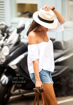 Love this off the shoulder top with the hat. Cool and casual.