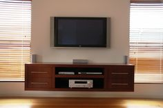Floating Shelves for TV Equipment | High gloss entertainment unit with push to open draws. Mitered Corners ...