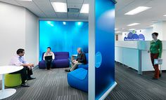 "The Audience brand is communicated through large scale wall graphics in clear, bold colors. The all-hands area features a ""wave motif"" alluding to sound waves. Collaboration and conference areas are identified with glass partitions in vibrant colors further reflecting the Audience brand."